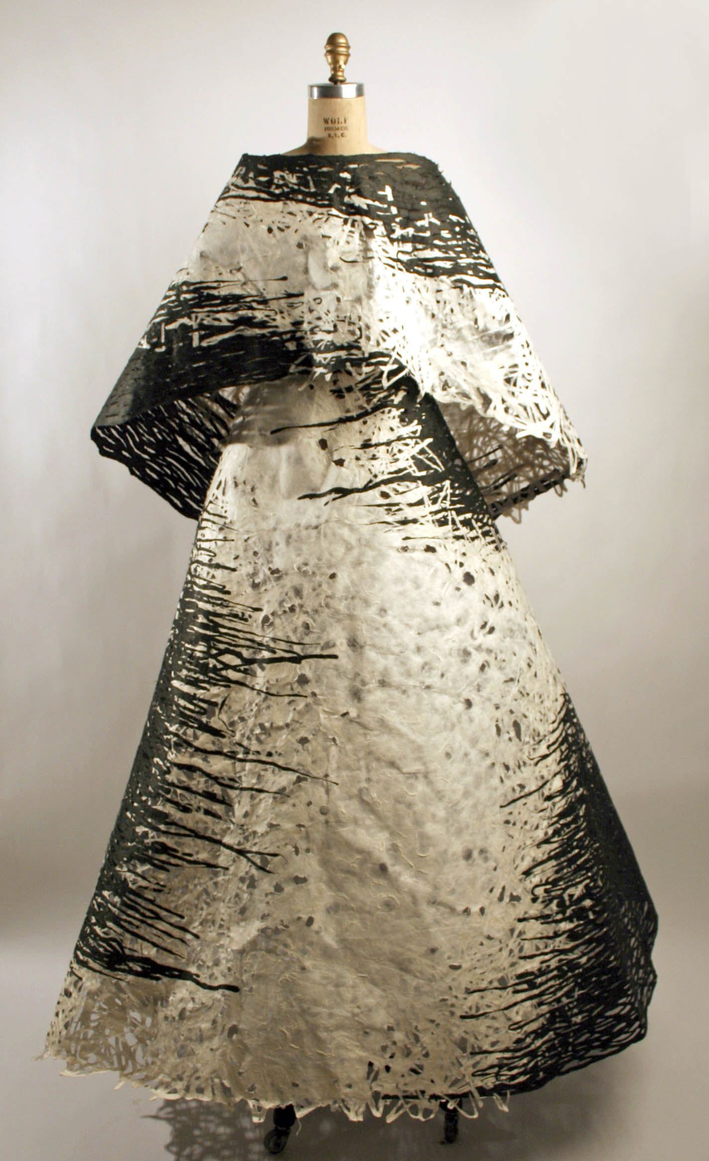 YUMI KATSURA from the Met Collection 2005      a) paper, synthetic; b) paper, synthetic, silk; c, d) synthetic  Dimensions:      Length at CB (a): 29 in. (73.7 cm) Length at CB (b): 52 in. (132.1 cm) Length at CB (c): 49 in. (124.5 cm) Length at CB (d): 21 in. (53.3 cm)  Credit Line:      Gift of Yumi Katsura, 2006