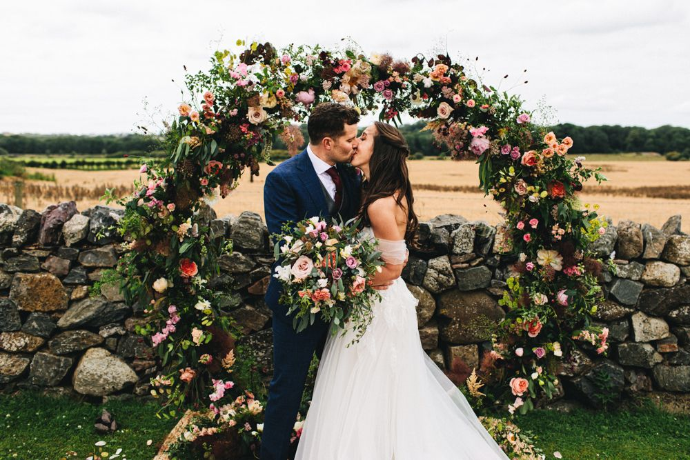 Moon Gate Wedding Flowers Outbuildings Wedding Jessica OShaughnessy Photography Moon Gate Flower Arch Ceremony Aisle Flowers Greenery Foliage Sweetpeas Freesias Peony Ros...