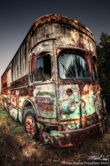 A Very Old And Rusty RV Sits In Salvage Yard Texas You Mean Night Bus