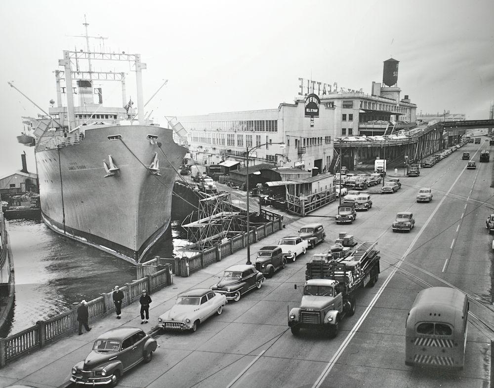 This press photo dated Oct. 23, 1953, gives us a great view of the port of Seattle, the James O'Hara and a wonderful assortment of cars and trucks along with a Navy bus.