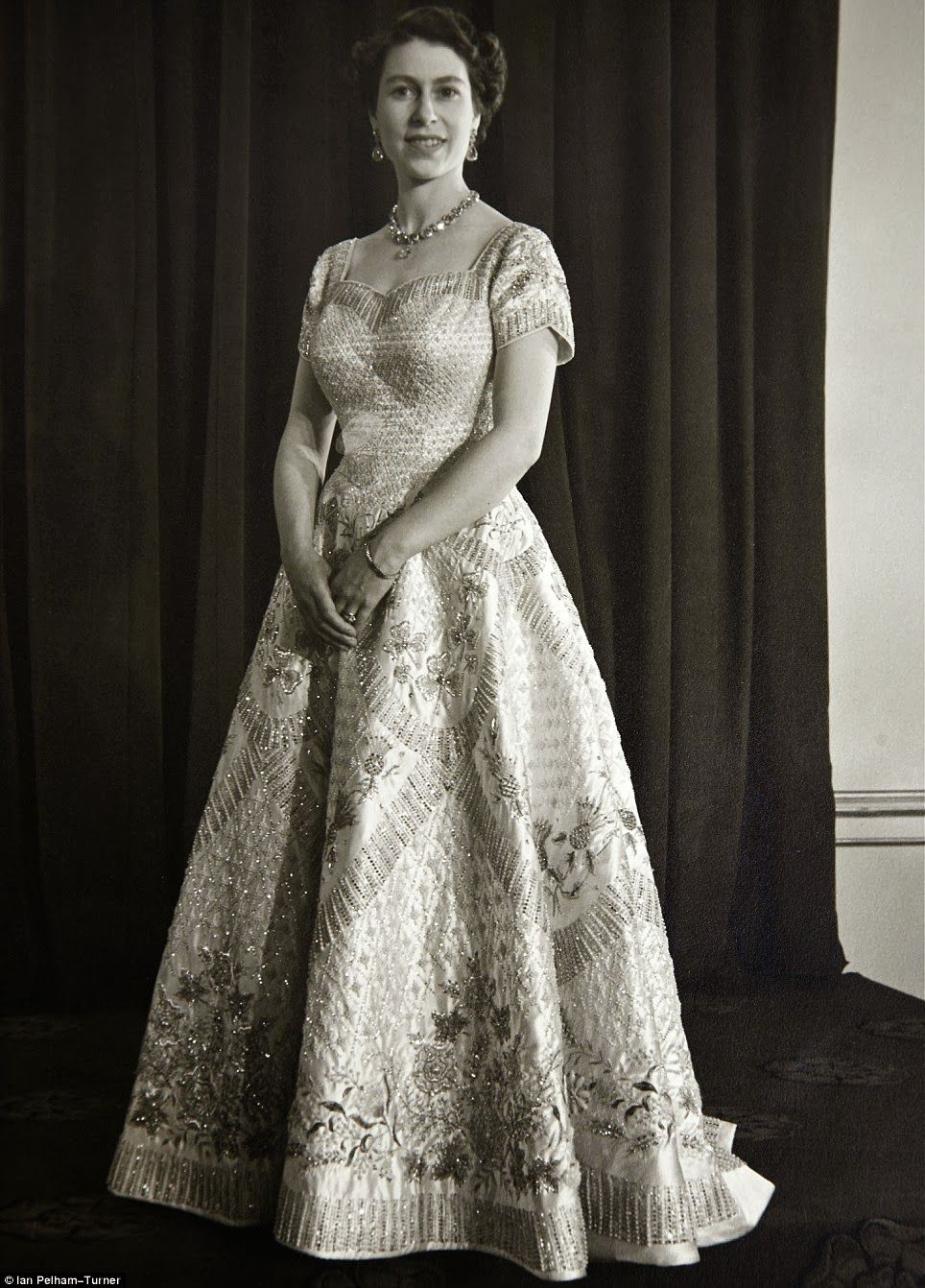 The Queen in her coronation gown that was designed by Sir