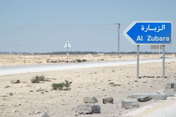 Signboard showing directions to Al Zubara
