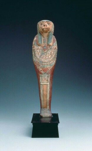 Wood and polychrome figure of Hapy, one of the four sons of Horus. Late Period…