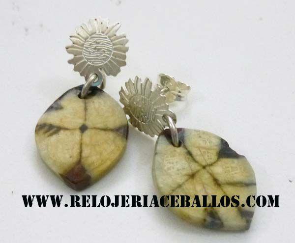 pendiente con flor de plata y quiastolita