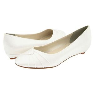 The Touch Ups Shirley is a low heel, dyeable pump. It has a round, pleated  toe. The Shirley is available in White Satin and sizes include 5 - medium,  ...