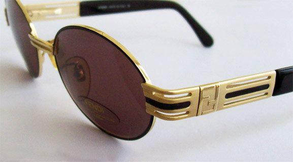 002251d09b80 Vintage Fendi Gold Brown Oval Sunglasses Mod. 7075 Made in Italy, medium  size, women, mint.. $79.95, via Etsy.
