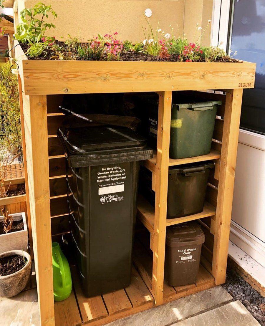 Mülltonnen- und Recyclinggeschäft mit Gründachpflanzgefäß