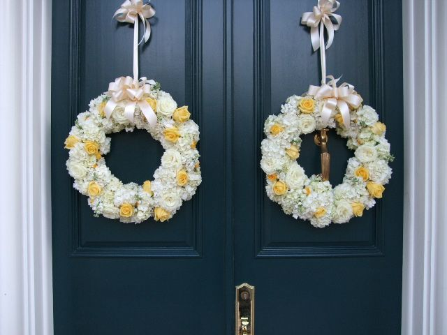 A beautiful way to greet your guests.  These wreaths adorn the doors to a home hosting a business reception.