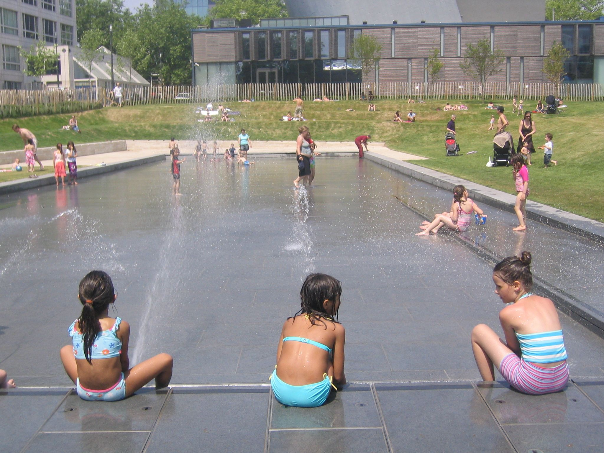 Children Playing With Water Feature