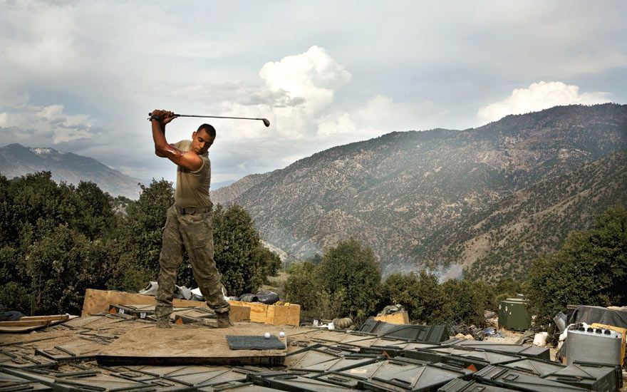 You Never See Them Like This, by Tim Hetherington. Sergeant Sterling Jones of the 2nd Battalion Airborne of the 503rd US Infantry practises his golf swing while on deployment in the Korengal Valley, Afghanistan, in April 2008.