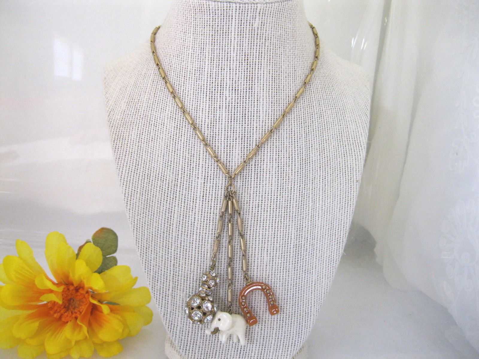 J crew gold tone long charm pendant necklace elephant horseshoe