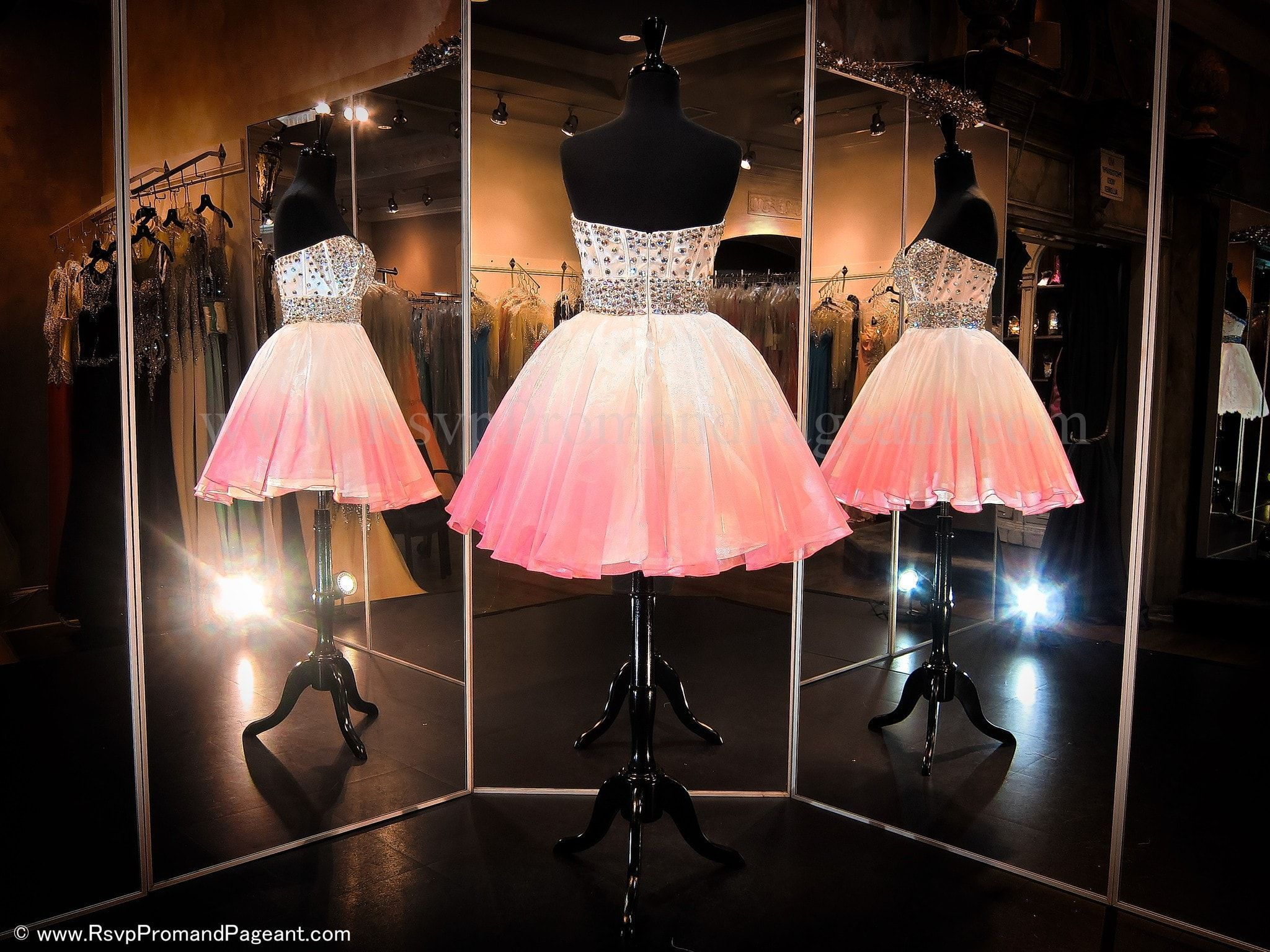 This sweet little dress features a heavy ab rhinestone beaded bodice