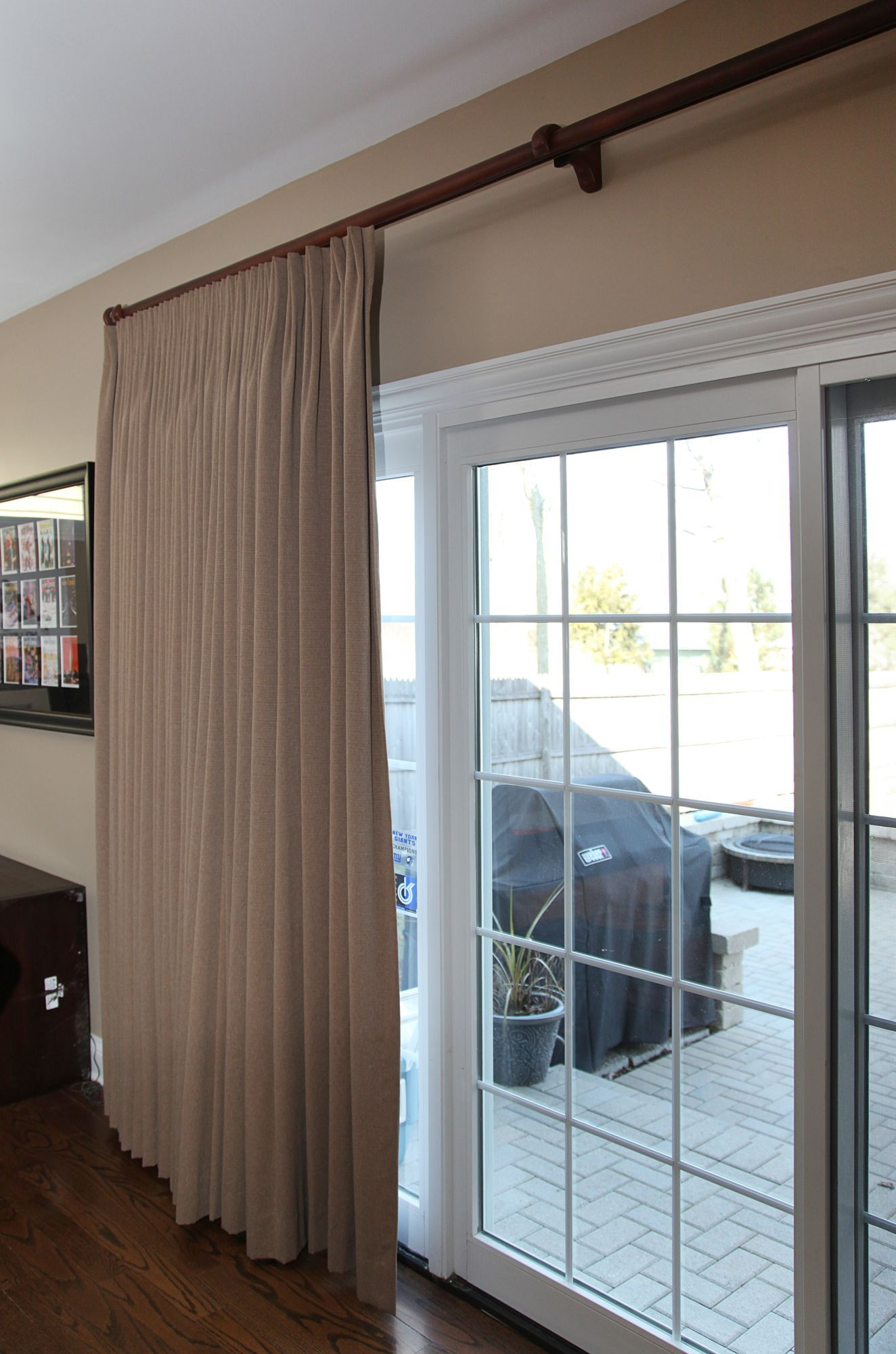 Traversing drapery on sliding glass door window coverings