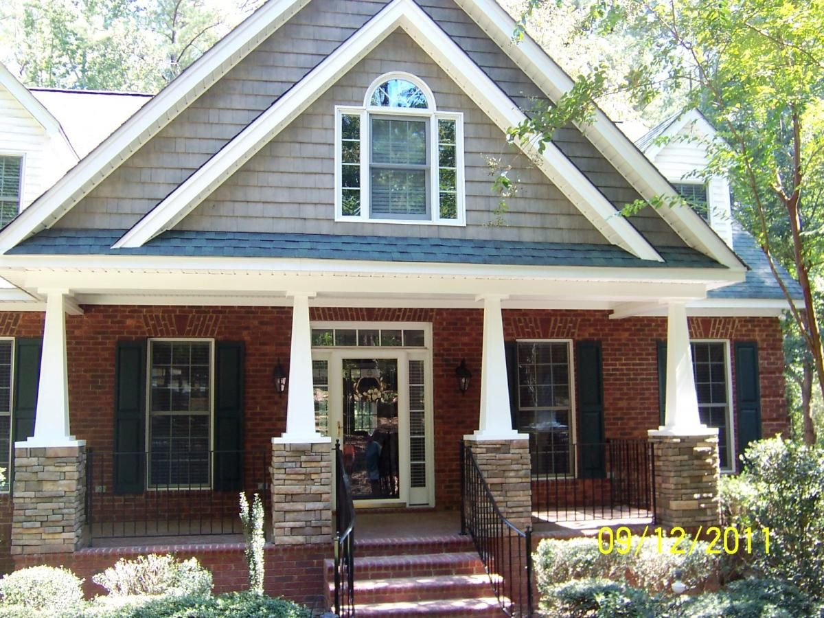 Exterior inspiring photo of front porch pillars idea including red brick wall combine with white pillars integrated with bricks iron black railing