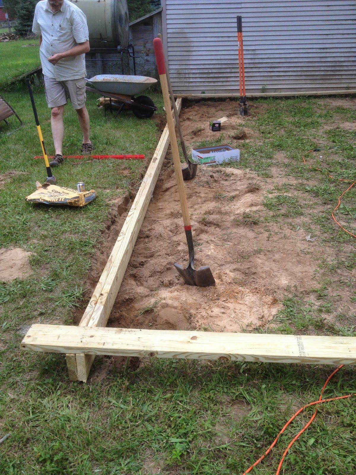 from dirt to deck how to build a ground level deck the wolven house project decks. Black Bedroom Furniture Sets. Home Design Ideas