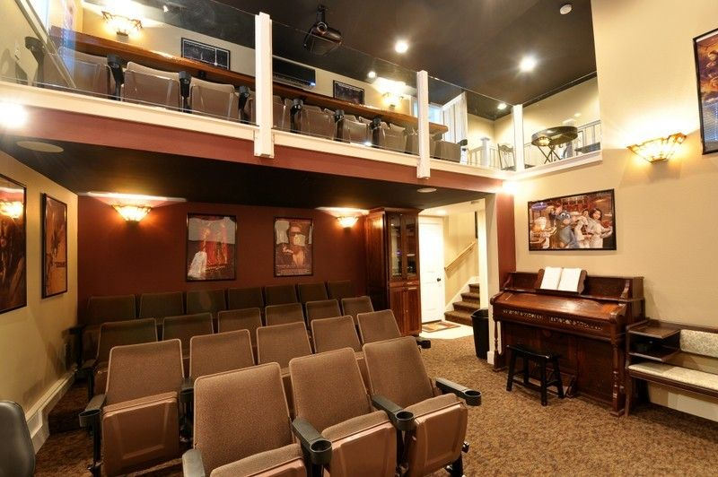 Amazing theater room with fireplace, 1/2 bath, organ, and