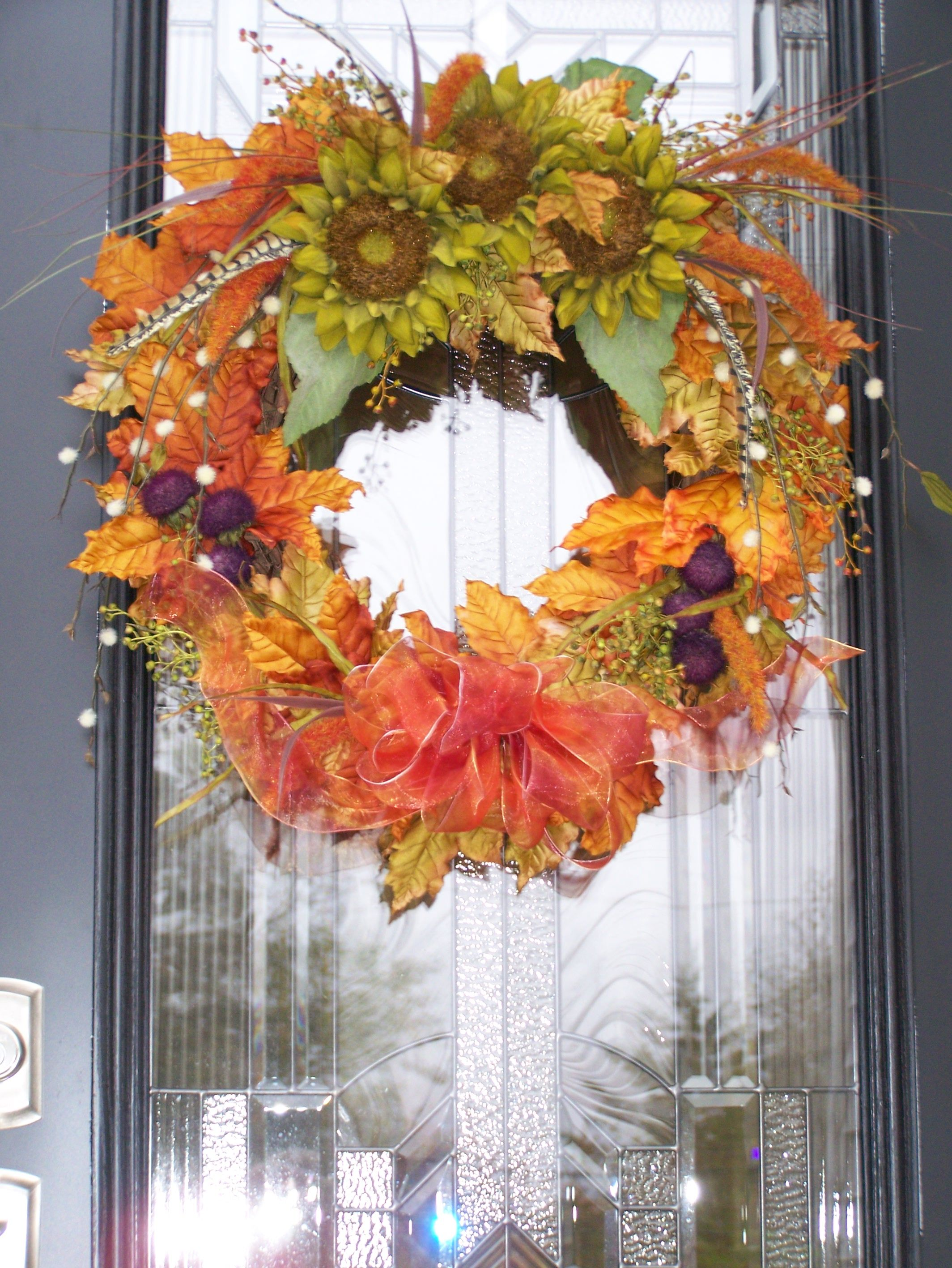 fall wreath made from silk flowers on a grapevine base ...