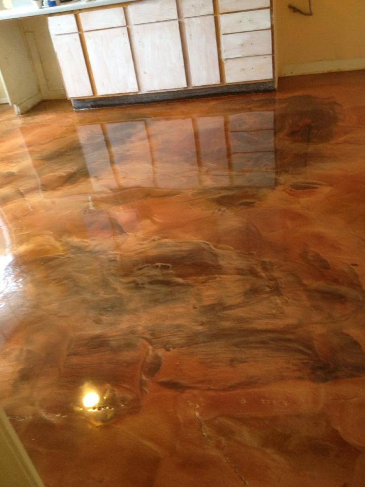 Metallic epoxy marble floor done in a coffee and brass for Colored concrete floors