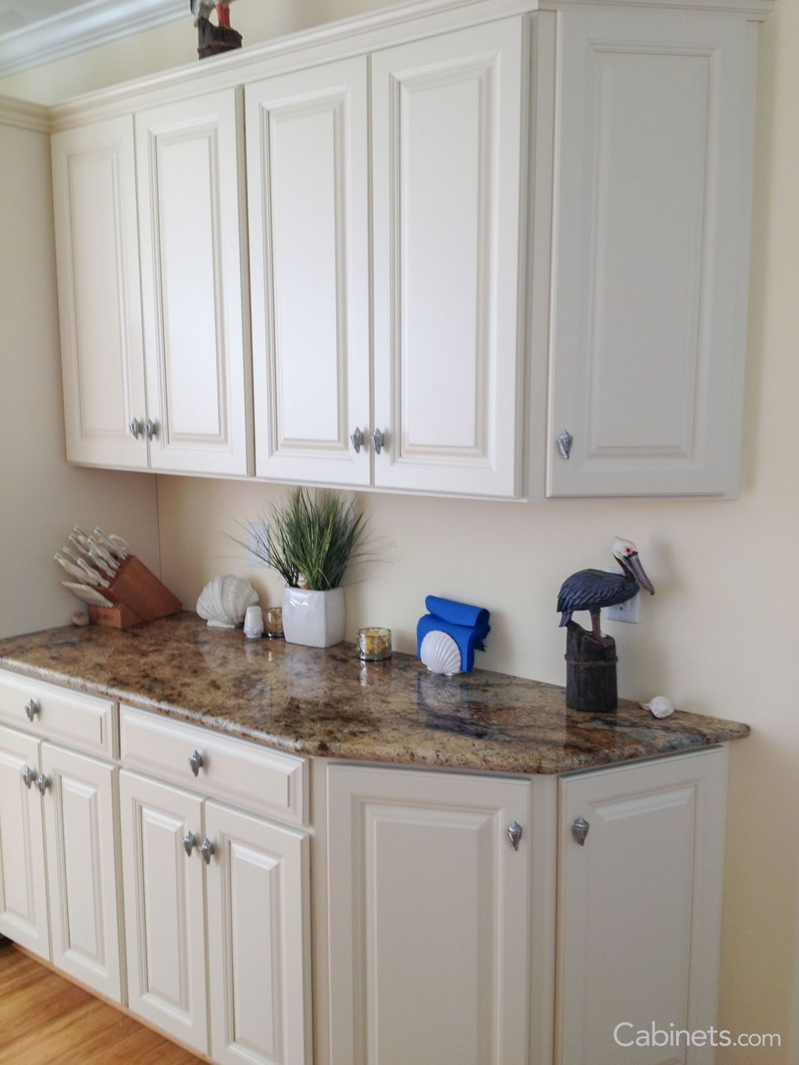 Use angle base cabinets, on a tight corner, they are a great depth ...