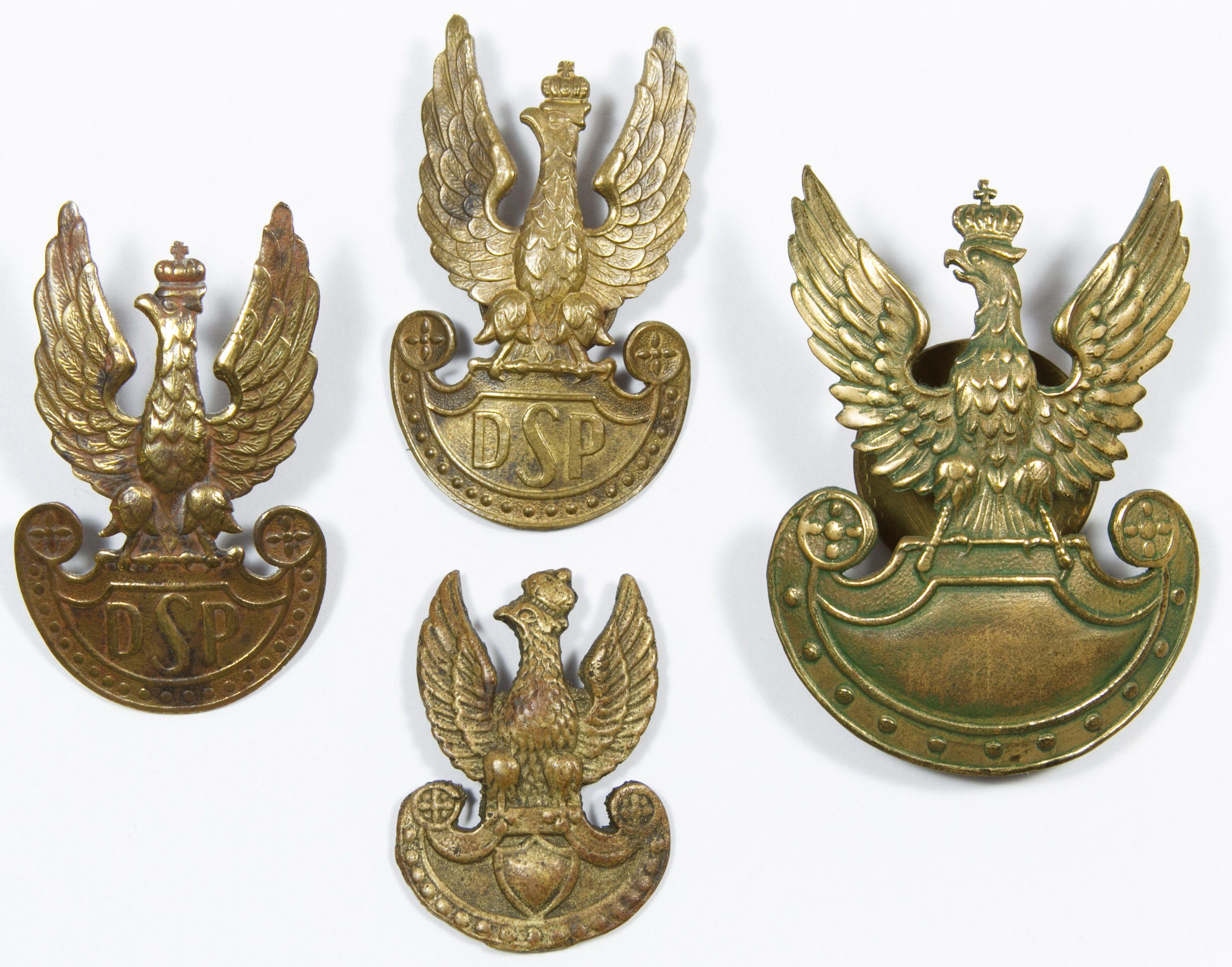Lot 480: World War II Era Polish Hat Badge Assortment