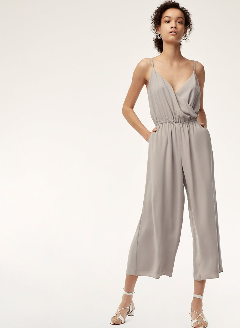 23b28e761 This is a sleeveless jumpsuit with a defined waist and V-neckline. It's  made with a lightweight Japanese crepe that has a matte finish.