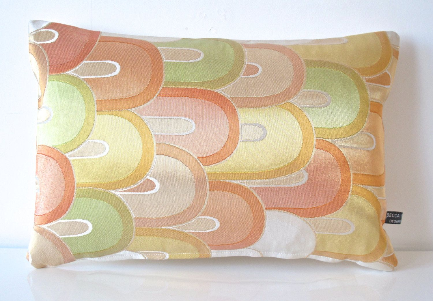 New spring collection silk cushion in a metallic pastel art deco
