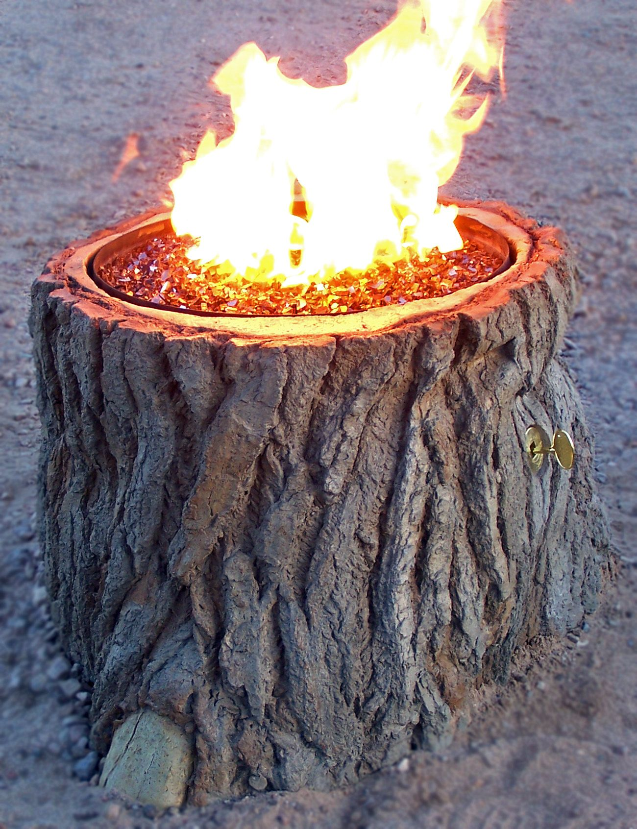 now thats a great looking tree stump fire pit built out of