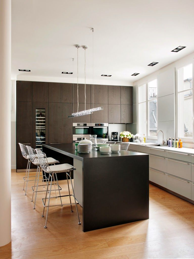 Dark cabinetry and counters with light floors