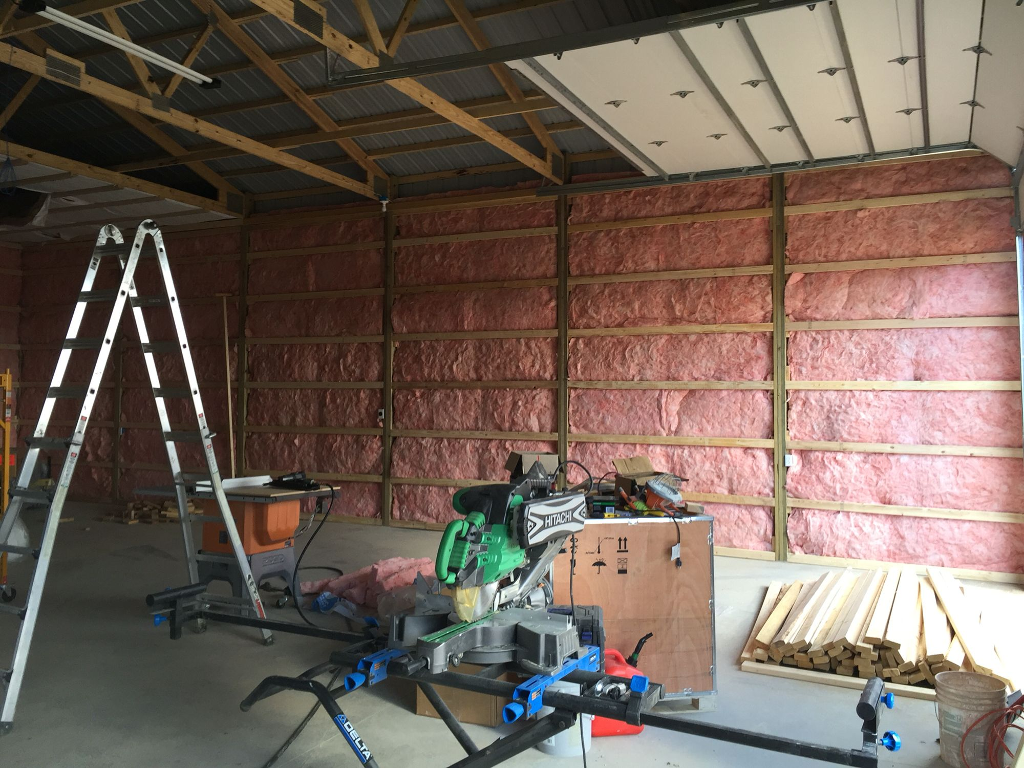 The Pole Barn Walls Are Filled With R19 Framed Out On 2 Centers And Ready To Cover With Osb Pole Barn Insulation Pole Barn Homes Pole Barn Construction