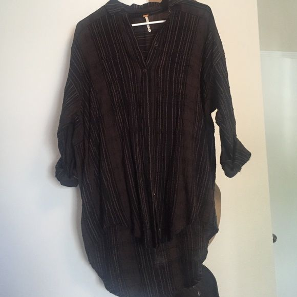 Free people oversized button down! Black and Tan striped oversized button down! Worn a couple of times, in perfect condition! Free People Tops Button Down Shirts