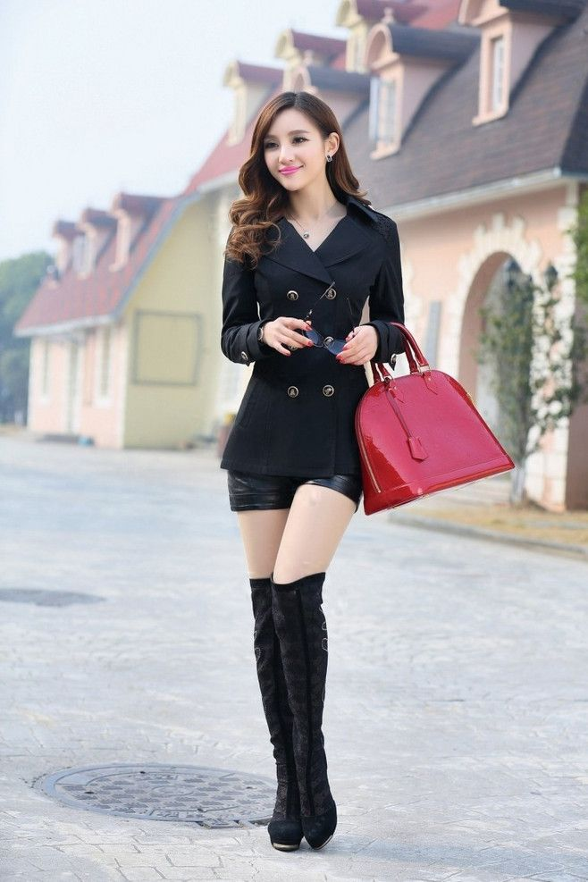 Asian girl in high boots consider