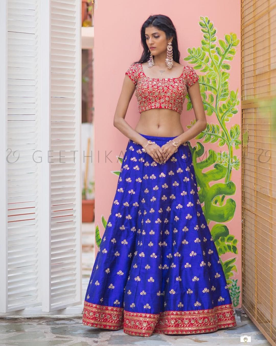 10497c15d9 GAYATRI ~ SSu201918. Stunning royal blue and candy red color combination  lehenga and red color blouse with hand embroidery work all over. 19 March  2018