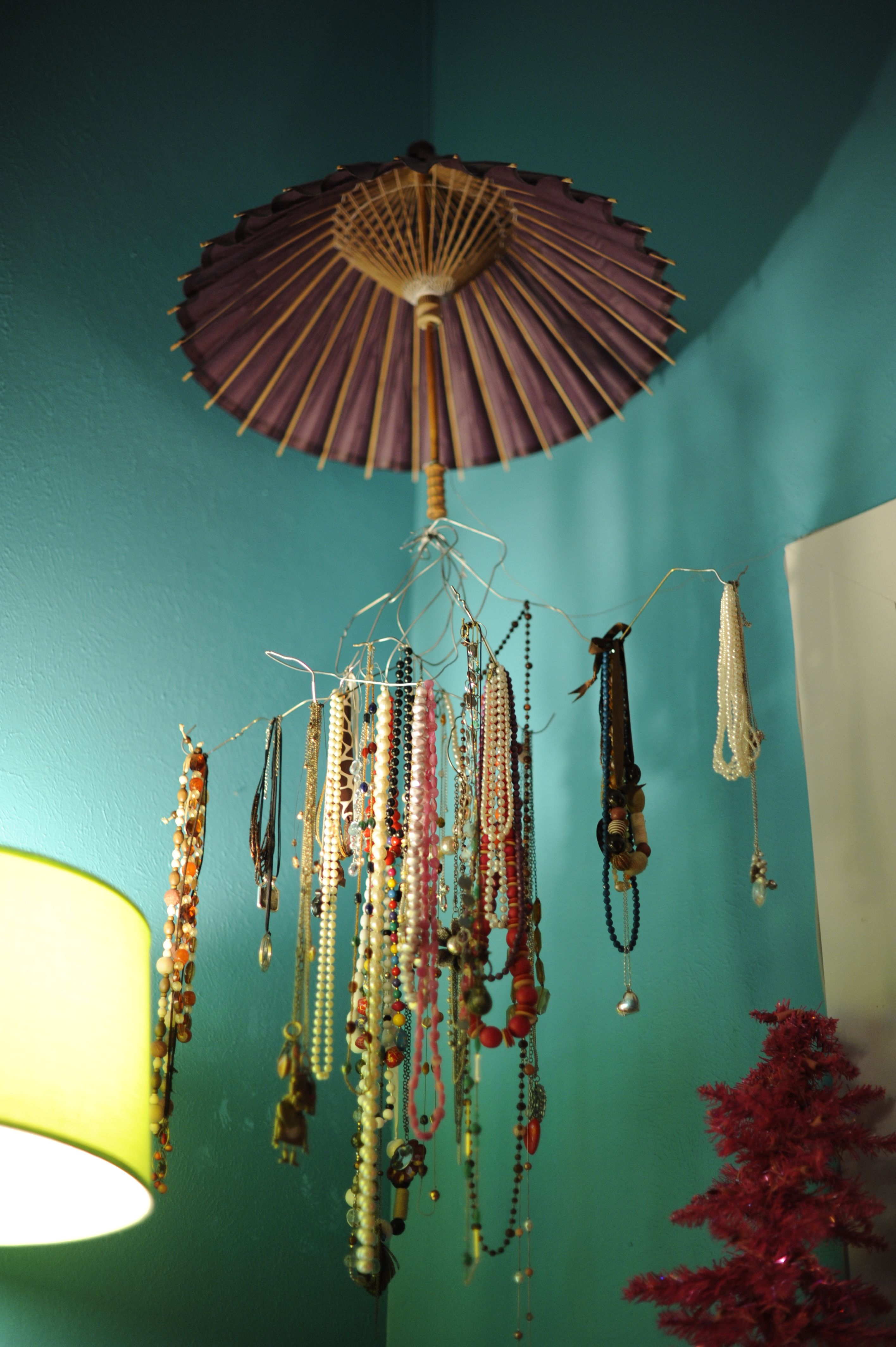 My sister\'s jewelry holder. Made from some old wire hangers and ...