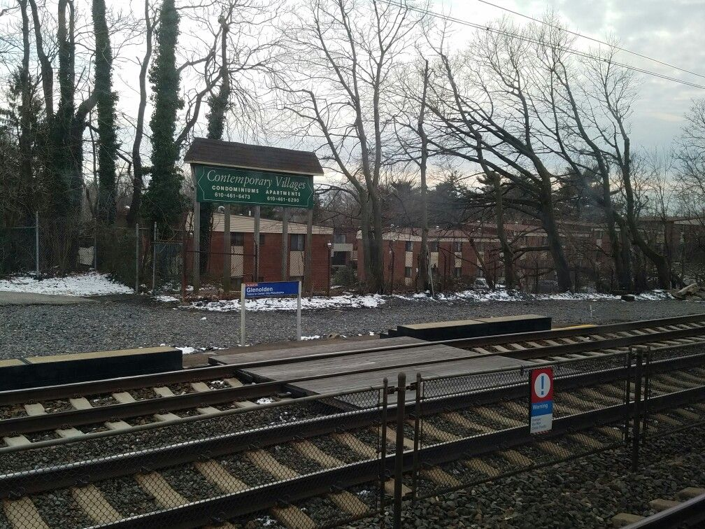 The Glenolden SEPTA regional rail station along the Wilmington/Newark line in Glenolden, PA. The Contemporary Village apartment complex is visible in the background.