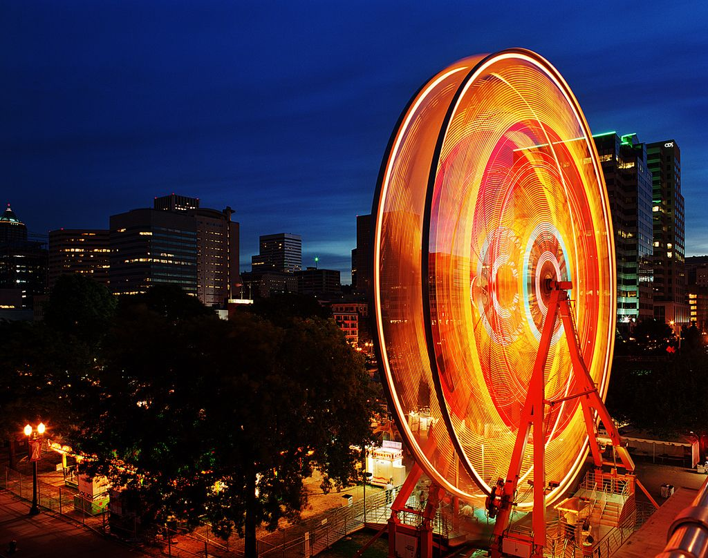 "https://flic.kr/p/6toYV7 | Ferris' Wheel | If one were to live in Portland in late May and early June, and they were to go downtown they would discover that the annual Rose Festival celebration would be in full swing.  A portion of that celebration involves the ""Fun Center"", which may or may not actually be a euphemism for ""overpriced stuffed Disney and Comic Book character knockoffs"".  Now in the middle of this ""Fun Center"" there is a generally a Ferris Wheel. ..."