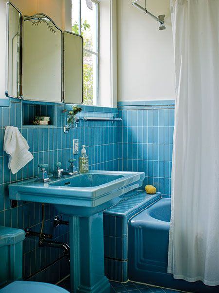 Instead of replacing all the vintage tiles and the bathtub Bright blue tile