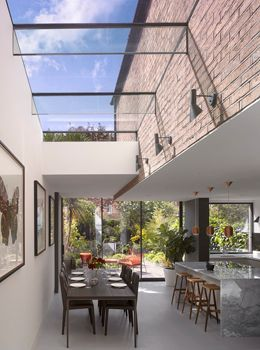 Amazing way of bringing outside inside with the extension. Paul Archer Design