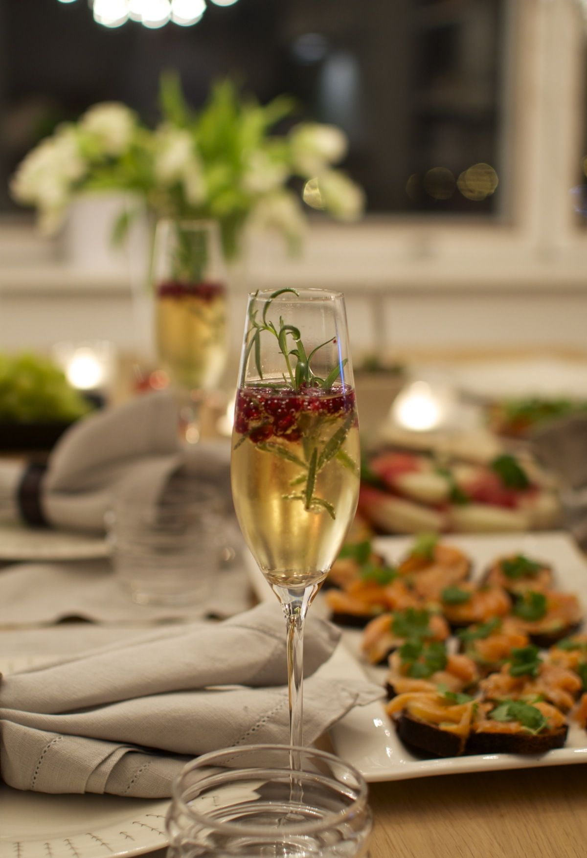 Champagne with rosemary and red berries