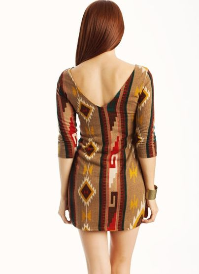 You'll be cute and cozy when you rock this tribal printed dress.