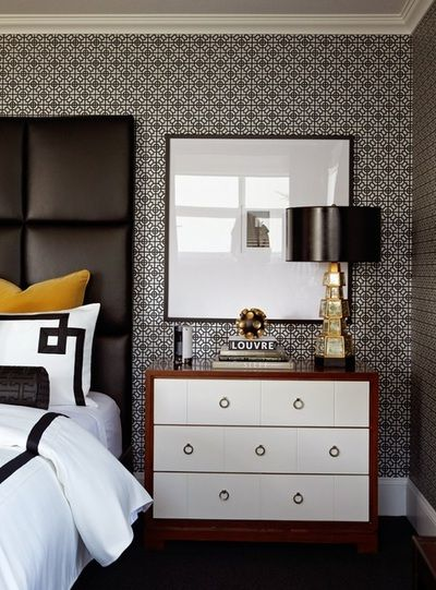 Masculine and contemporary bedroom with a black leather ...