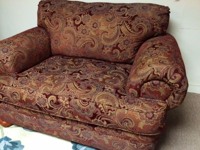 paisley print chair and a half in red and camel tones
