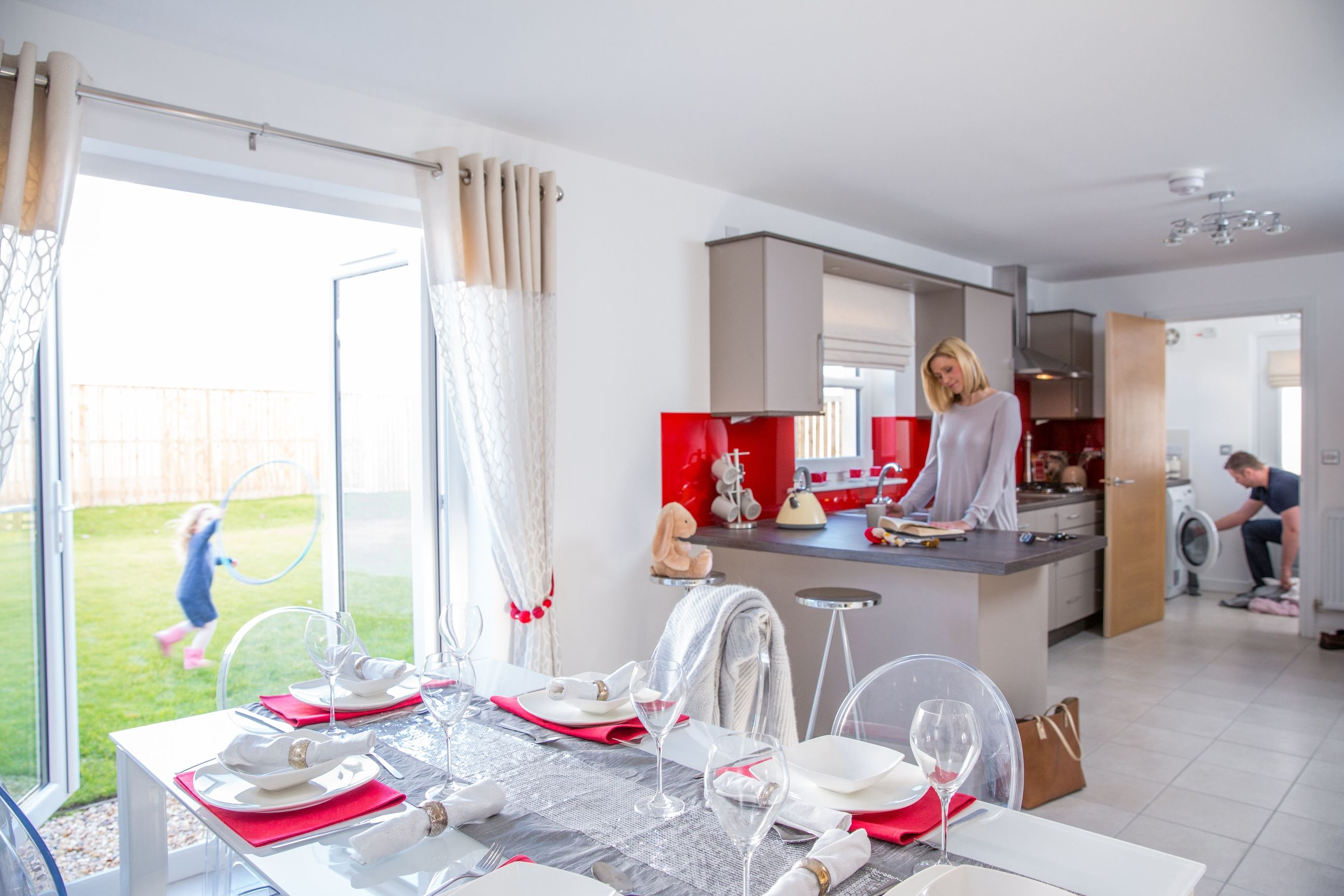 Modern neutral kitchen with bright red accessories in The Bressay ...