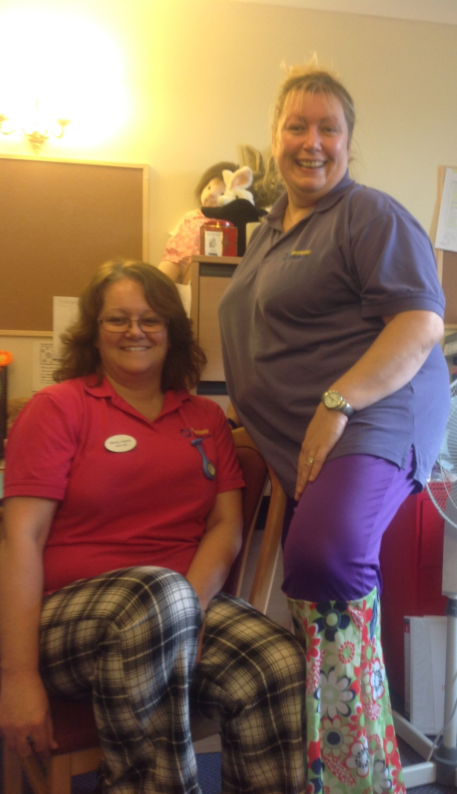 Sarah and Mandy proudly show off their WRONG trousers for Children In Need! We're Loving the Rupert the bear & 70's flares look