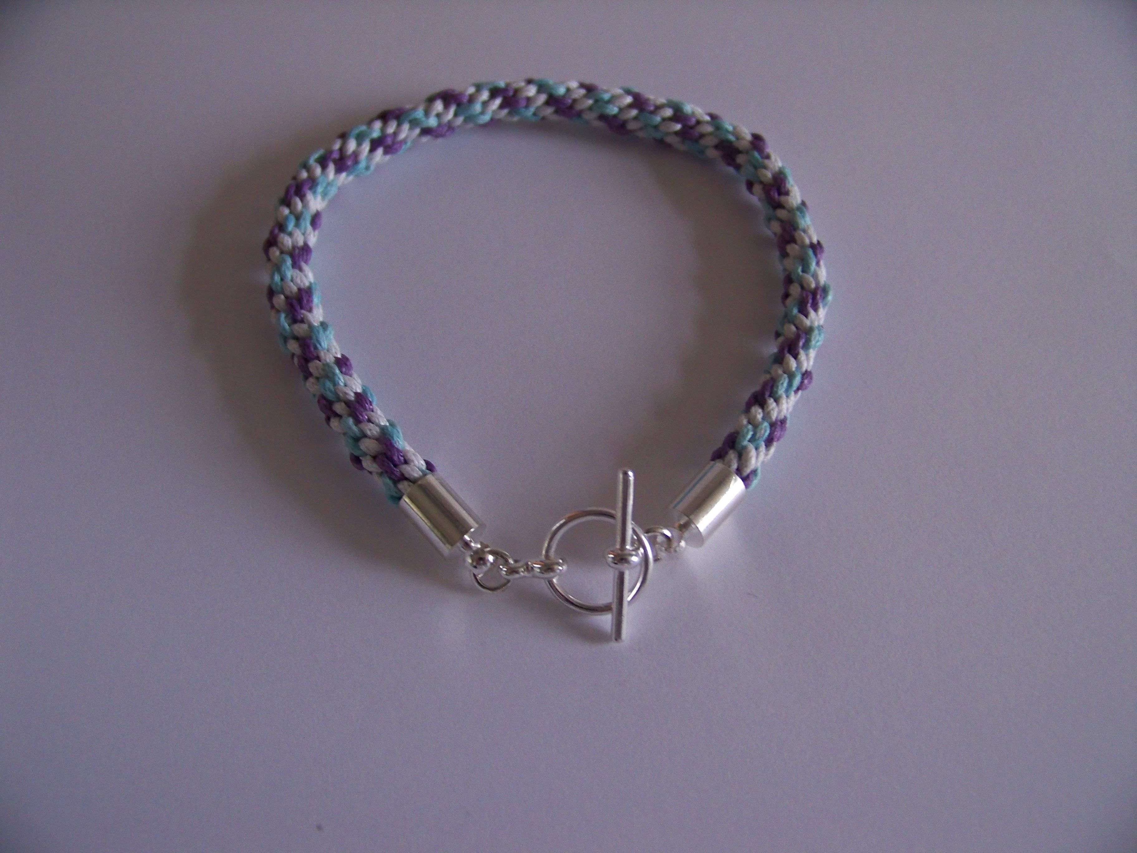 This Kumihimo Bracelet is made using 1mm Waxed Cord in White, Lilac and Aqua.