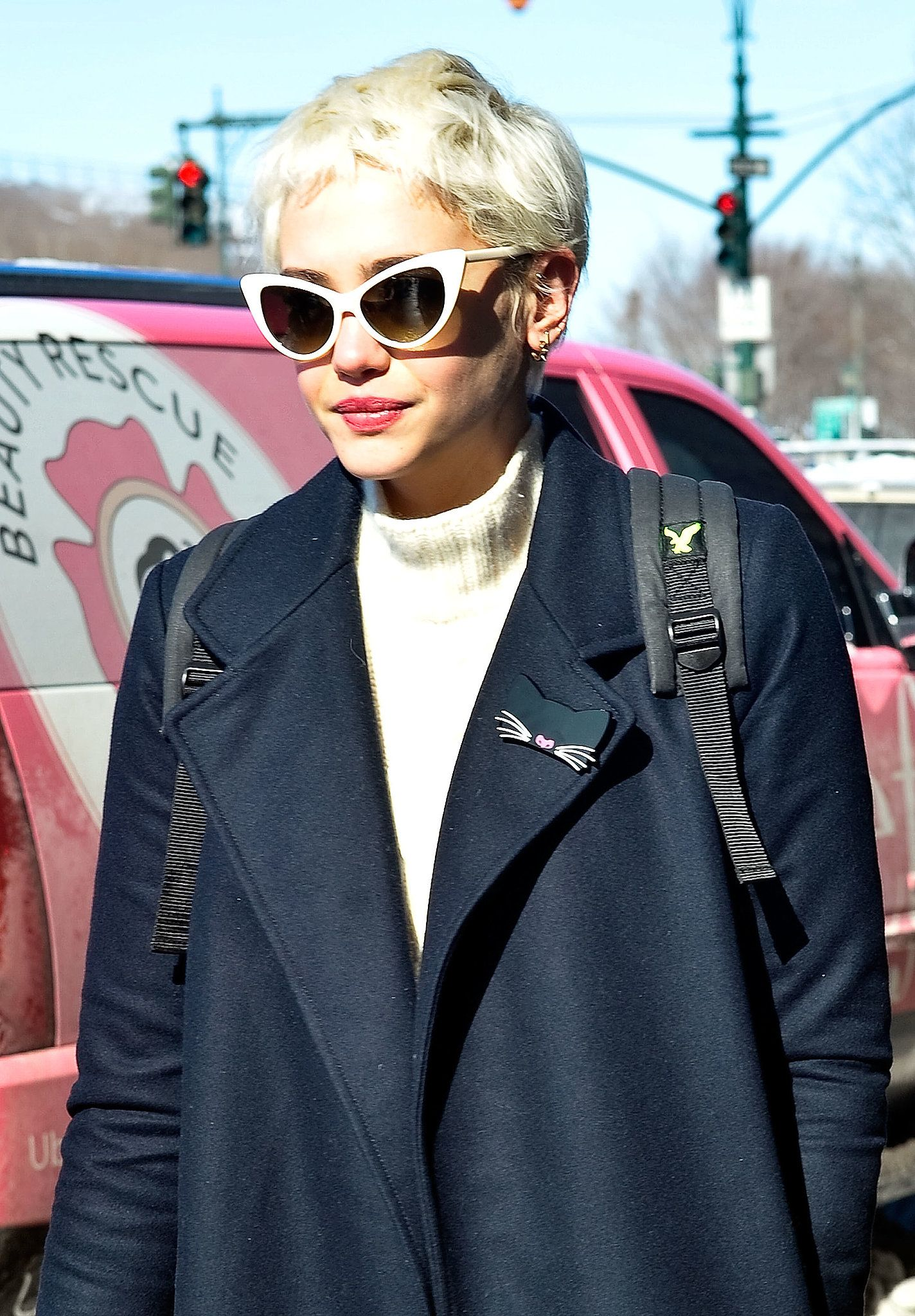 A bleached pixie cut got the vintage treatment with cat-eye sunglasses and beautiful peach lipstick.