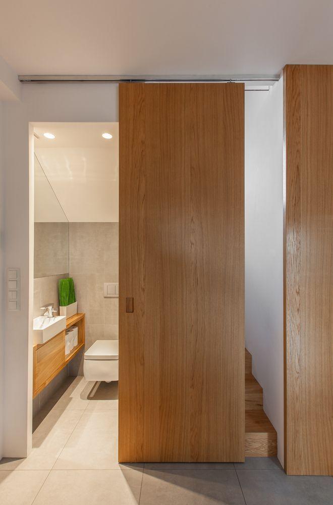 Small House Harmonizes Functions Through Simplicity Sliding Door Design Simple House Design Door Design