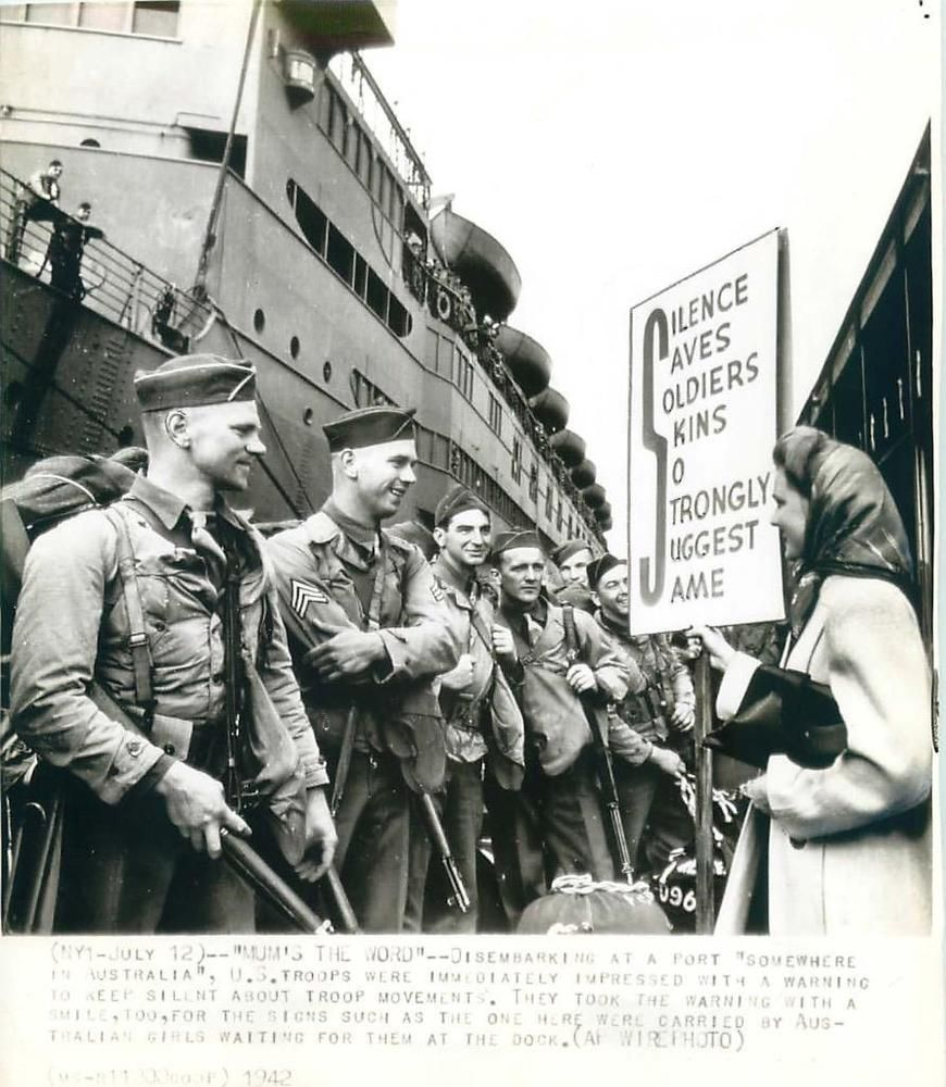 1942 U S Soldiers Met By Girls Carrying Warning Signs Reminding Troops To Keep Silent About Troop Movements Sign Reads Silenc Wwii American History History