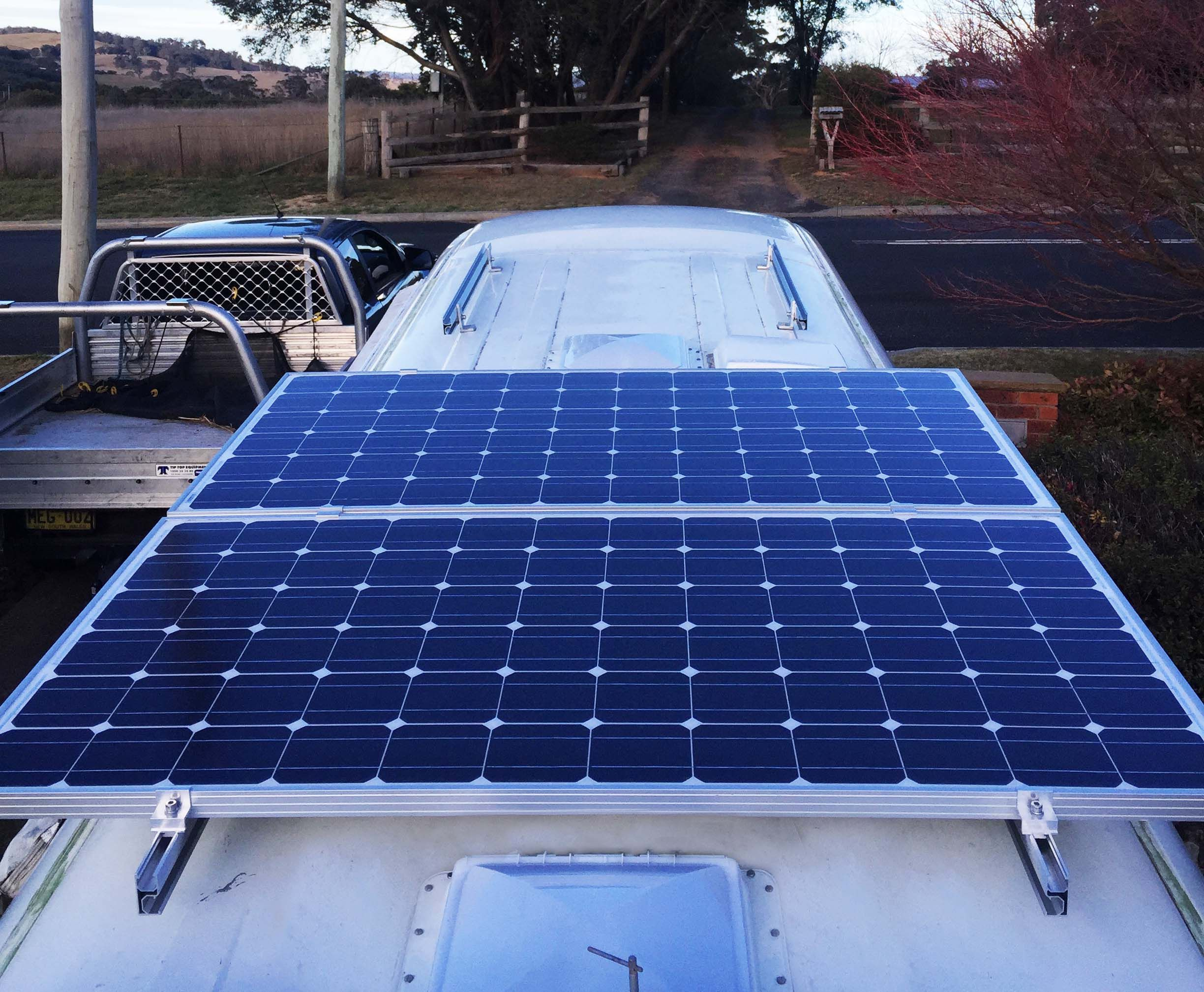 2x 220 Watt Panels We Ve Since Added A 3rd To The Front Mounting Racks As Well To Give Us 660 Watts We Us Solar Panel Cost Solar Panels For Home Solar Panels