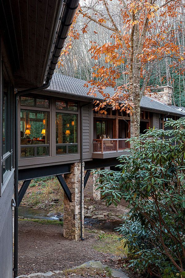 Bridge House nestled in a forested landscape