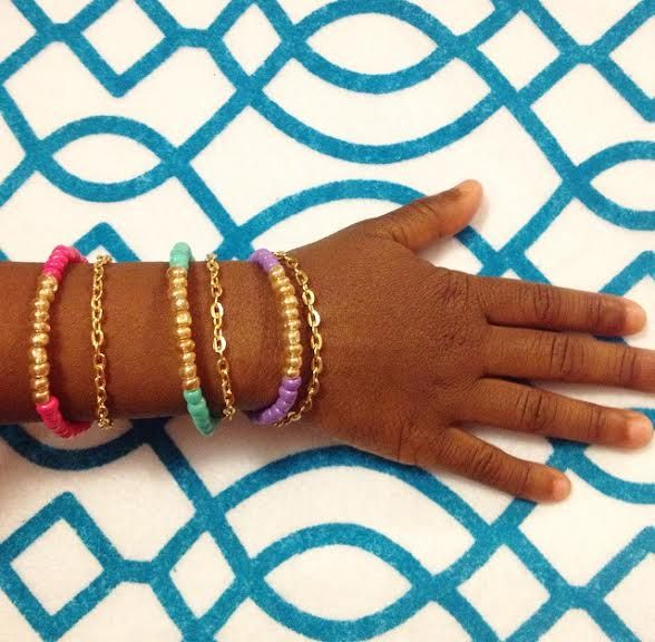 Little girls love princess things! This gorgeous double bracelet is full of cuteness! It comes in 3 beautiful colors; hot pink, teal, & purple! With a gold chain attached to each bracelet, this is the perfect accessory & will definitely look stylish on any wrist! This bracelet looks perfect alone...